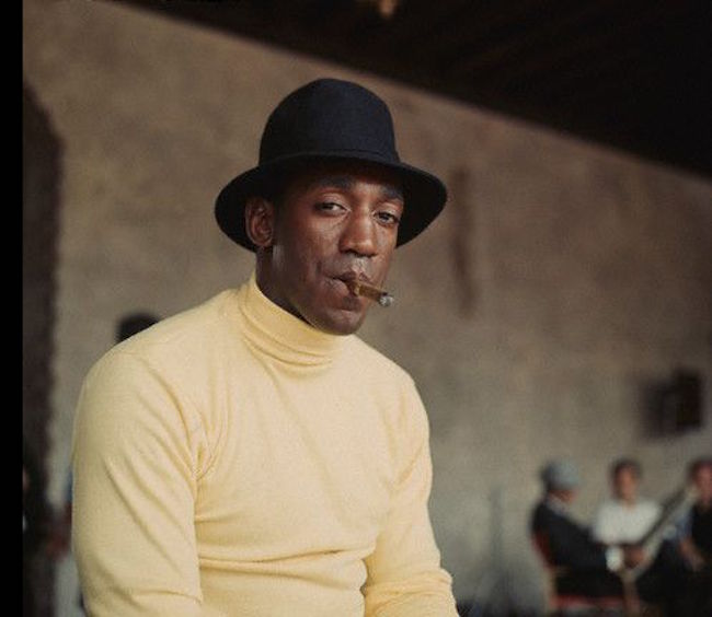 Portrait of Bill Cosby smoking a cigar. --- Image by © CORBIS